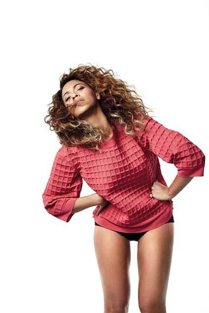 Wearing a Chanel waffle sweatshirt and Nina Ricci bikini bottoms - May 2013 British Vogue cover